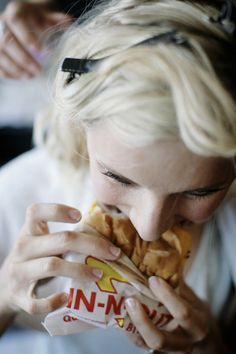 a bride who isn't afraid to eat on her wedding day (before even getting into her dress actually!).  awesome.