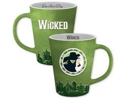 """Enjoy your morning coffee in the One Short Day Wicked mug. This ceramic mug is coated in green to reflect the colors worn by the characters, as well as the primary color of the set. It features a clock face and witch illustration, along with the Wicked logo and the song name """"One Short Day"""" in cursive on the inner rim. A must for Wicked fans. Green Mugs, Cursive, Morning Coffee, Primary Colors, Theatre, Broadway, Wicked, Witch, Fans"""