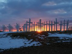 Crosses installed during a highway safety improvement movement 1 -  Crosses on a hill between Reykjavik and Selfoss mark highway deaths on Iceland's Highway 1 east.  A movement to have the highway improved installed this stark reminder to impress the need for a better road.  The movement succeeded and the highway has been made safer.  Note the tiny cross hanging from the arm of a larger cross in the third row from the left.  Undoubtedly a child mortality.