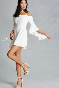 A woven swing dress featuring an open-shoulder design, 3/4 bell sleeves with ruffle trim, adjustable spaghetti straps, and a concealed back zipper. This is an independent brand and not a Forever 21 branded item.