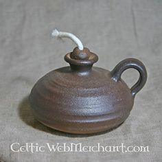 LAMP - Medieval oil lamp.  This handmade medieval oil lamp is based on originals that were used between the 10th to 15th century AD. This lamp is made of clay from the Rhinelands. Earthenwork from the Rhinelands was used all over Europe during the Middle Ages.