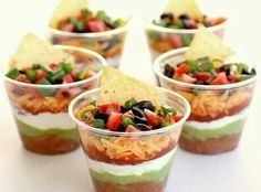 Individual 7 layer taco dip. They look great in clear plastic cups. #yum! #colorfulsnack