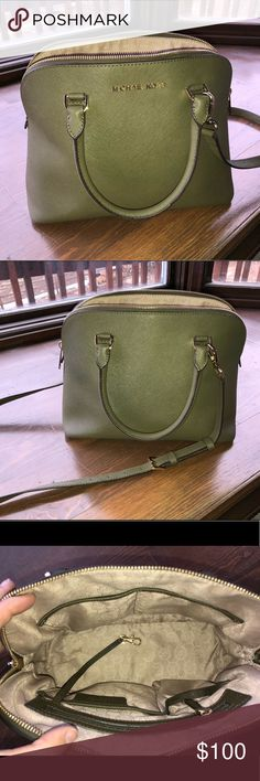 Michael Kors Purse Medium sized MK purse olive green. No rips no stains. Measured about 11-12 inches in length. Beautiful purse selling because I have my eye on something else!  Wouldn't be selling if I didn't want this other purse. Michael Kors Bags