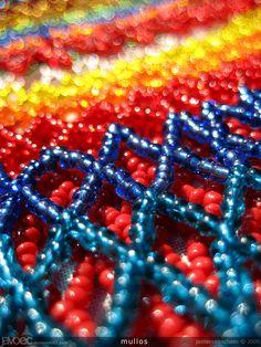mullo: (from uncertain origin) noun (ecuador) bead of a rosary or necklace (string of beads).  --  mullo: (de origen incierto) sustantivo masculino (ecuador) abalorio o cuenta de rosario o collar.