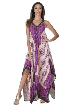Sweeping scarf print maxi dress with V-neckline and adjustable shoulder straps. A dramatic hankie hem defines this plus size dress.
