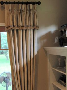 goblet pleat drapery panels with attached valance & trim . . . sometimes called the french flip