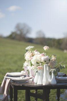 white and pink table decor #weddingreception #pastelflorals #weddingchicks http://www.weddingchicks.com/2014/01/27/pastel-sheep-wedding-inspiration