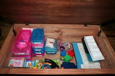 Another pinner said: My game storage idea.  Put all parts of a game in a school supply box. The boards stack neatly to the side.    These are stored in a trunk, but it works equally well on a shelf. :)
