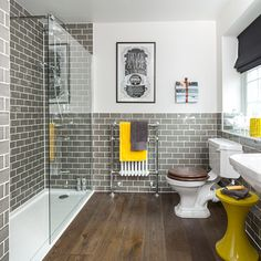 Wood,vinyl? floors and walk in shower, as well as grey tiles. Especially like it with the yellow.