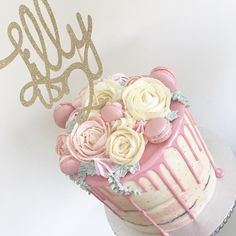 Pink and cream buttercream flowers cake for a sweet girl's birthday. Semi naked with a pink drip and buttercream roses, plus a glittery gold cake topper