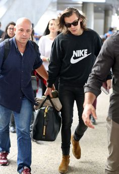 Harry Styles Spotted in Black Nike Sweatshirt at LAX image Harry Styles NIKE…