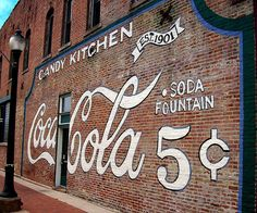 Coca-Cola Wall This wall advertising Coca-Cola for 5 cents is for the Flesor's Candy Kitchen located in Tuscola, Illinois.