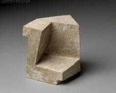 Escultura en piedra. 6,5 x 6 x 6 cm.