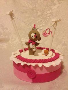 Tedy bear in clitingline cake