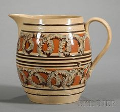 Double Earthworm Decorated Mochaware Pitcher, Britain, c. 1830, barrel-form pearlware jug with thin brown bands and rouletted diamon...