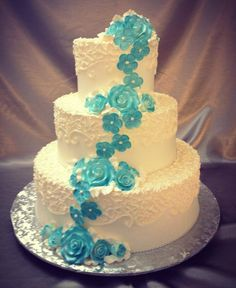 caskading flowers white and blue wedding cake savoia pastry shoppe rochester ny