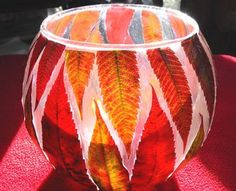 Leaf lanterns by Twig and Toadstool  modpodge leaves onto glass bowl