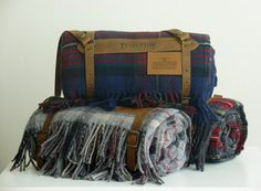 Wool blanket with leather carrier. Great for camping, cabins, cars, etc!