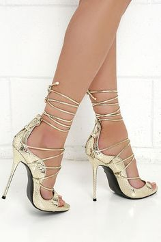 When your song comes on, the Party Anthem Gold Snakeskin Lace-Up Heels will keep you on the dance floor! Metallic snakeskin-embossed vegan leather creates a luxe look over a peep toe, and curvy vamp that laces up above a sturdy heel cup.