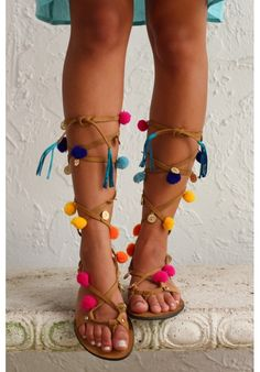 Genuine leather lace up sandals with pom poms, tassels and gold coin embellishments