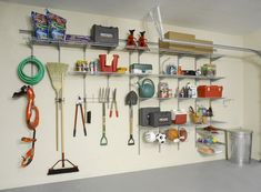 Turn a garage wall into an organized center for tools, gardening supplies and sports equipment with ClosetMaid's Heavy Duty Wire Shelving. Small Garage Organization, Garage Wall Storage, Garage Storage Systems, Garage Walls, Storage Organization, Organized Garage, Diy Storage, Garage Shelving, Basement Storage