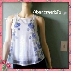 Abercrombie and Fitch Sequin Floral Top <>HP Beautiful sequin top by Abercrombie and Fitch for the flagship exclusive. Blue floral design. This piece can be dressed up for a night out or dressed down for a casual day.  No swaps![][] Bundle for discount[][] Abercrombie & Fitch Tops