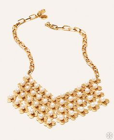The classic look of quatrefoil — made modern in gleaming gold and pearls