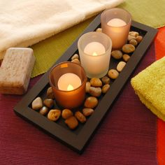 Create an rustic outdoor atmosphere indoors with this earth tone pebble candle tray. This wooden candle tray painted in a warm soft black comes with three frosted earth tone glass candleholders and smooth pebbles. The glass candleholders will hold a Diy Candles, Tea Light Candles, Diy Candle Tray, Glass Votive Holders, Wooden Candle Holders, Led Tea Lights, Tray Decor, Wedding Decor, Rustic Wedding