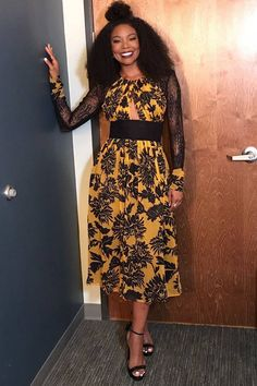 Gabrielle Union has a smile that can surely light up the room and her yellow and black floral dress is a hit | ESSENCE.COM