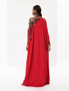 Product Description A dramatic caftan belongs in every woman's wardrobe. Cut from vivid crimson stretch-georgette with a floor-sweeping hem and cascade sleeves, this one is detailed with an illusion shoulder bordered by sequin flower embroidery. Frock Fashion, Abaya Fashion, Couture Fashion, Fashion Outfits, Long African Dresses, Latest African Fashion Dresses, Lace Dress Styles, Mode Abaya, Caftan Dress