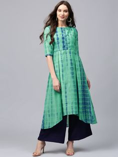 Buy Libas Women Green Chanderi Silk Dyed A-Line Kurta online in India at best price.Green and blue dyed A-line kurta , has a round neck, short sleeves, short hook-and-eye placket, asymmetric Indian Attire, Indian Ethnic Wear, Indian Outfits, Kurta Designs Women, Blouse Designs, A Line Kurti, Kurti Designs Party Wear, Designs For Dresses, Indian Designer Wear