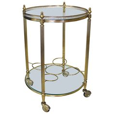 French Brass Two-Tier Bar Cart or Side Table | From a unique collection of antique and modern bar carts at https://www.1stdibs.com/furniture/tables/bar-carts/