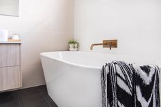 Bathroom design by SIBA Interiors. This bath is the perfect solution for anyone who wants a freestanding bath in a tighter space. It backs up to the wall therefore saving (cleaning) and space. #winwin