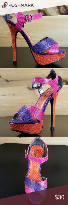 Luichiny Bowtie Size 8 Color Block high Heel Multi color snake print upper full of hot pink, purple and orange.  Two crossing straps at the vamp, an adjustable ankle strap,  1 inch platform and 5 inch heel give you everything you could want from a chic sandal.  Signature Heart Stamp Sole Email us with any questions More sizes available Twf.shoes Luichiny Shoes Heels
