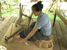 Euay Navon from northern Laos demonstrates traditional cotton production, while wearing entirely handmade cotton clothing. She is at the LIving Crafts Centre of Ock Pop Tok in Luang Prabang.