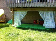 Under the deck play house I like but use shower curtain