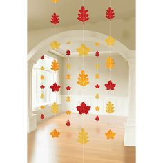 Enjoy falling leaves indoors with Leaf String Hanging Decorations. The strings feature beautiful foil leaf shapes in Autumn colors like dark orange, yellow and gold. The leaves hang on strings that at