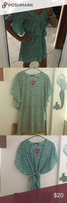 Teal&white flutter dress with tie Very flattering with butterfly sleeves and optional tie which makes the waist looks small. Could be worn with white skinny jeans or as a nice dress. Never worn, tags still on Trixxi Dresses Midi