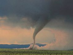 "A tornado is ""a violently rotating column of air, in contact with the ground ...  weathermonitorsplusblog.com"