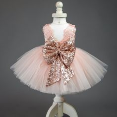 Isnt+this+the+prettiest+dress+EVER! Perfect+for+weddings,+birthdays,+photo+shoots+or+everyday+dahls+wardrobes. Made+in+bubbly+pink+lace,+with+a+pink+tutu+style+skirt+bottom,+adorned+with+an+oversized+pink+sequined+bow. + We+have+sizes+0/3+months+-+7/8+girls+ Our+current+turnaround+...