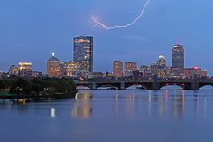 City of Boston skyline photography at twilight showing landmarks such as John Hancock building, Prudential Center and Longfellow Bridge while thunder and lightning move through the composition.  Good light and happy photo making!  My best,  Juergen www.RothGalleries.com www.ExploringTheLight.com http://whereintheworldisjuergen.blogspot.com https://www.facebook.com/naturefineart @NatureFineArt