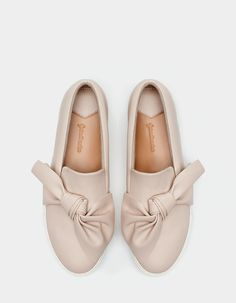 At Stradivarius you'll find 1 Slip ons with bow trim for woman for just 29.95 €…