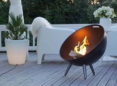 One of the many lovely things about the Eva Solo Fire Globe is that it's portable. You can move it from your rear patio, to your interior courtyard, to your rooftop terrace. So simple and so beautiful. Available in our Outdoor section at Obtain Design #outdoordesign #evasolo #fireglobe #firepit #danishdesign #scandinavian #minimalist