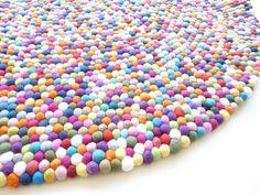 http://downthatlittlelane.com.au/happy-as-larry-designs/product/4741-smartie-felt-ball-rug-180cm