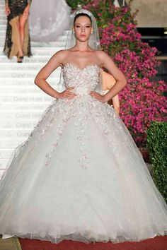 Gorgeous long white wedding dress with handmade lace with white and pale pink flowers. With this dress you will feel like a princess and your
