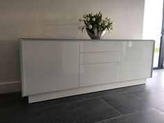 Modular BOOK sideboard. Sideboard with ceramic frame and glass fronted doors. This sideboard have two doors and a set of drawers. Delivered to our client in Kent.
