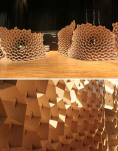"Each honeycomb 'cell' is uniquely angled to provide a defined focal point, steering the gaze of viewers onto specific objects behind the wall. ""Each element of the structure is unique, generated by algorithms based on the location of the wall and the locations of the items exhibited. Once generated, the element shapes were transferred directly to a CNC mill for fabrication,"""