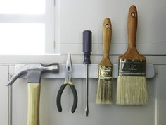 Re-imagining uses for things is something we do at MSLO all the time.  Here a magnetic knife rack from IKEA (ikea.com) intended for the kitchen is used to hold tools and thoroughly dry damp paint brushes before storing them.