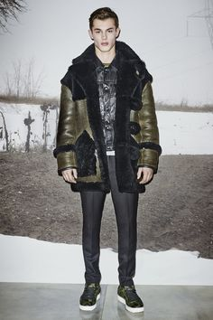 A look from the #CoachMens2015 presentation: the Military Shearling Car Coat, Black Leather Jean Jacket, Grey Heather/Military Ringer T-Shirt, Black Wool Trousers, Feather Necklace and Wild Beast Lo-Top