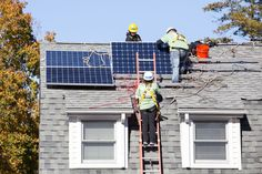 Volunteers from Viridian's corporate team work with professionals from GRID Alternatives to install a solar energy system in Port Chester, New York. (Photo: Business Wire)
